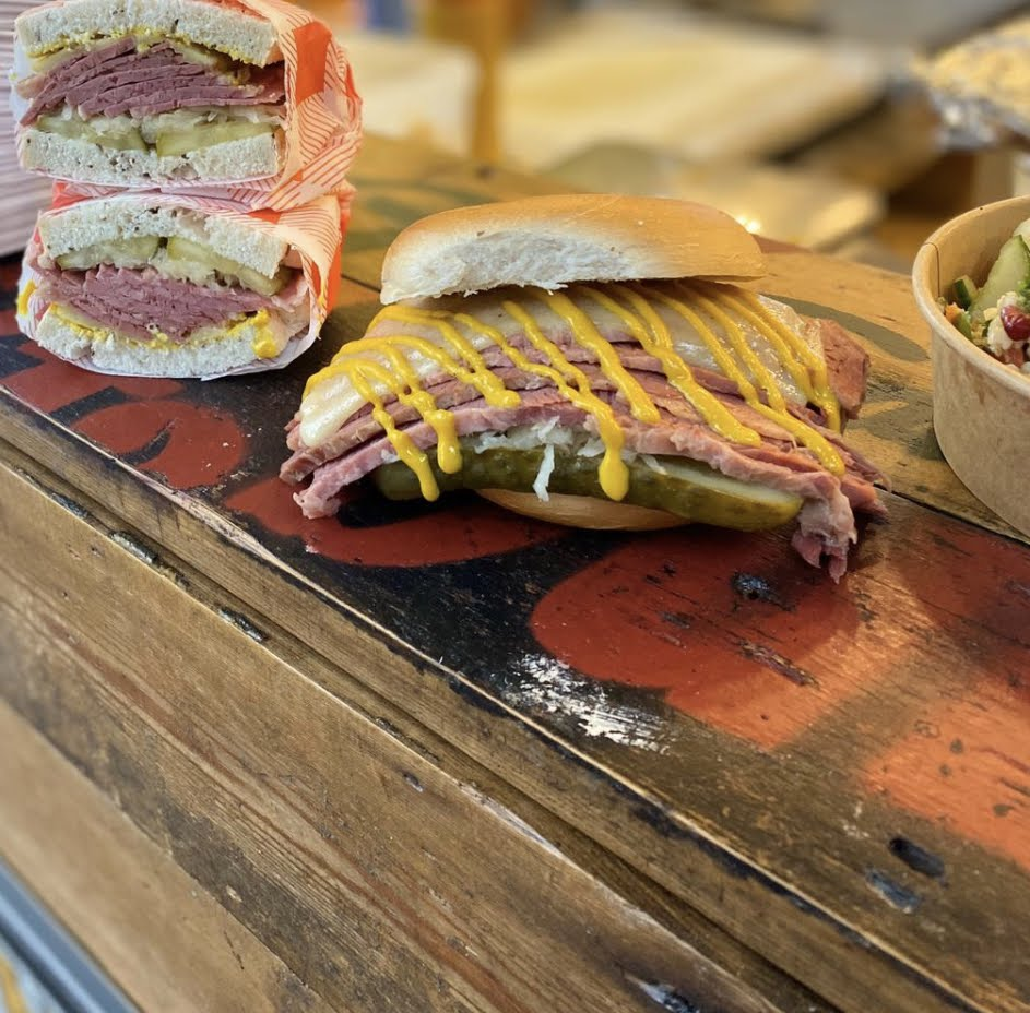 image showing Brick Lane bagels and rye stuffed with salt beef brisket served with pickles and mustard and available at our Borough Market location and Broadway Mar