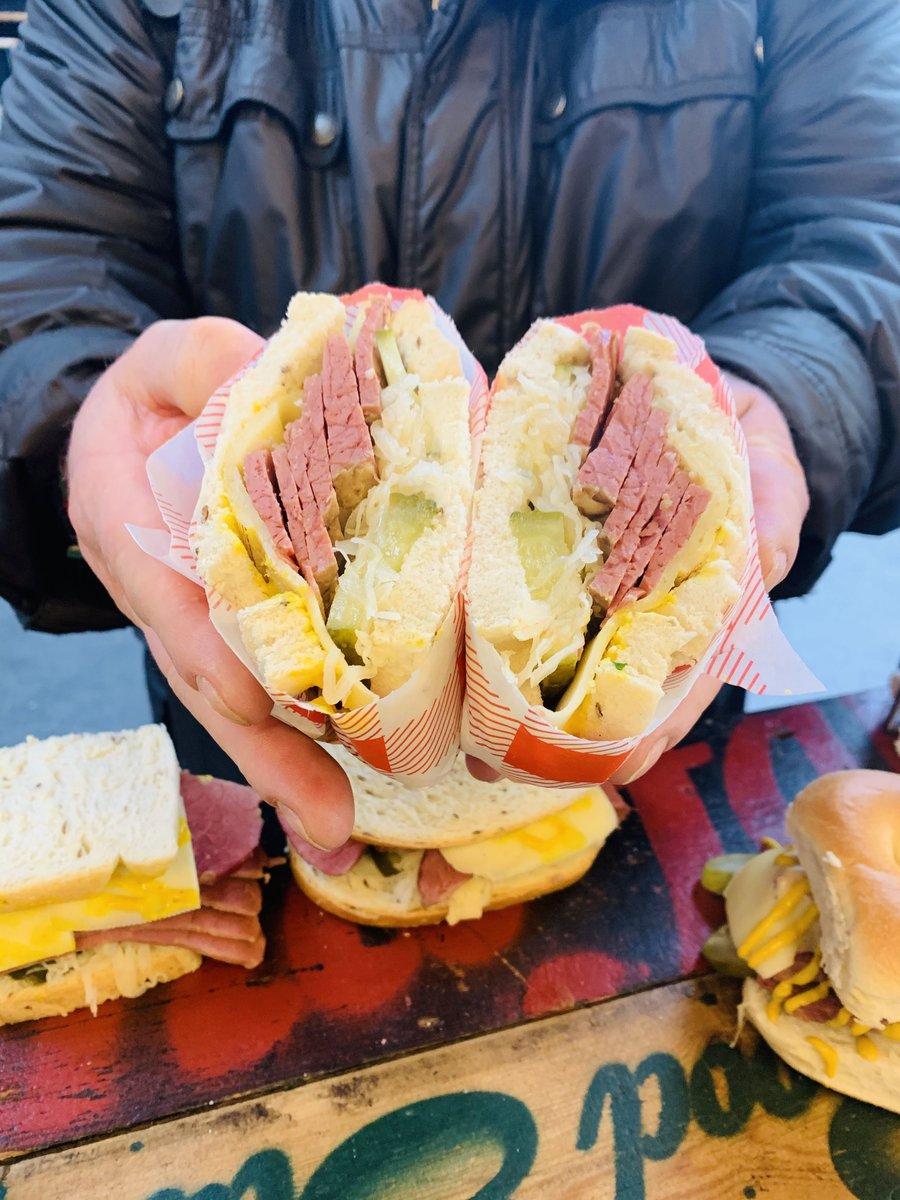 image showing A customers salt beef on rye bread sandwich. Salt beef brisket at its best